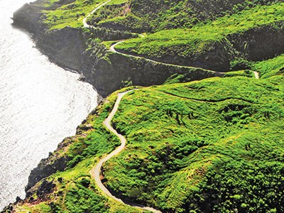 The winding road from Kahului to Hana features breathtaking oceanic vistas and roadside waterfalls with swimming holes.