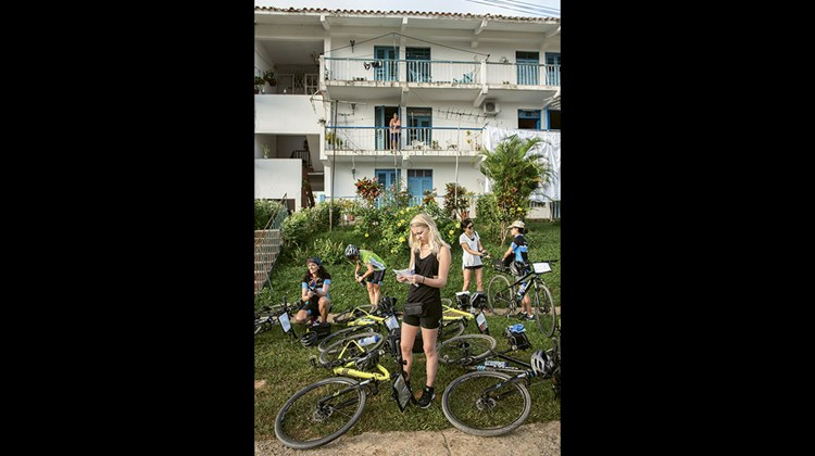 Backroads riders in Vinales prepare for a day on the road through western Cuba's countryside. The tour offers three daily route options to accommodate guests' route interests and fitness levels.