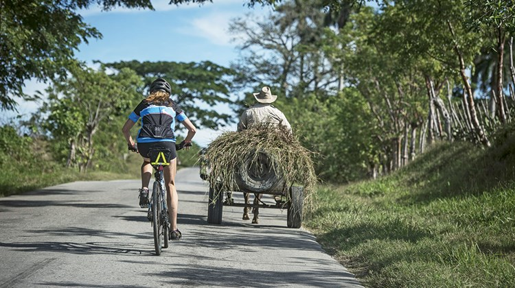 This year adventure travel specialist Backroads launched its Cuba Bike Tour, a people-to-people itinerary that enables guests to experience the country's ''national parks, rum and Latin rhythms.'' Pictured, a rider on the 26-mile Backroads Caimito Route in western Cuba.