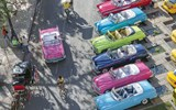Classic cars turned taxis next to Havana's historic Parque Central.