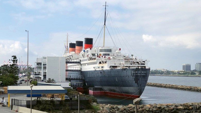 An aft view of the Queen Mary, a 1936 ocean liner that is now a floating hotel, in Long Beach, Calif.