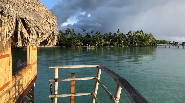 The deck and ladder into the lagoon from a private overwater bungalow at Le Taha'a Island Resort & Spa.