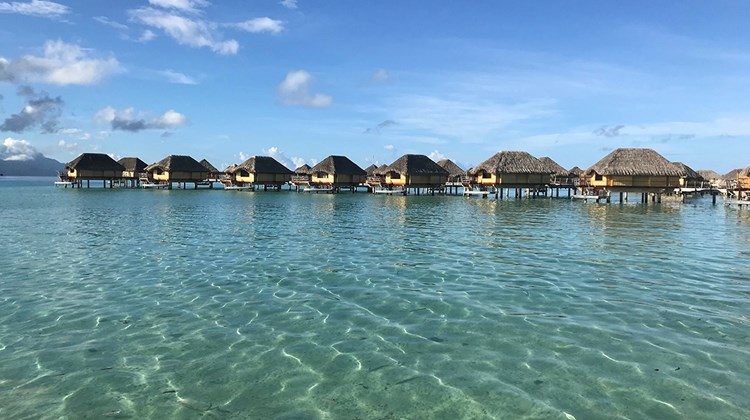 A row of overwater villas at Le Taha'a Island Resort & Spa, which is a 45-minute boat transfer from the Raiatea airport.