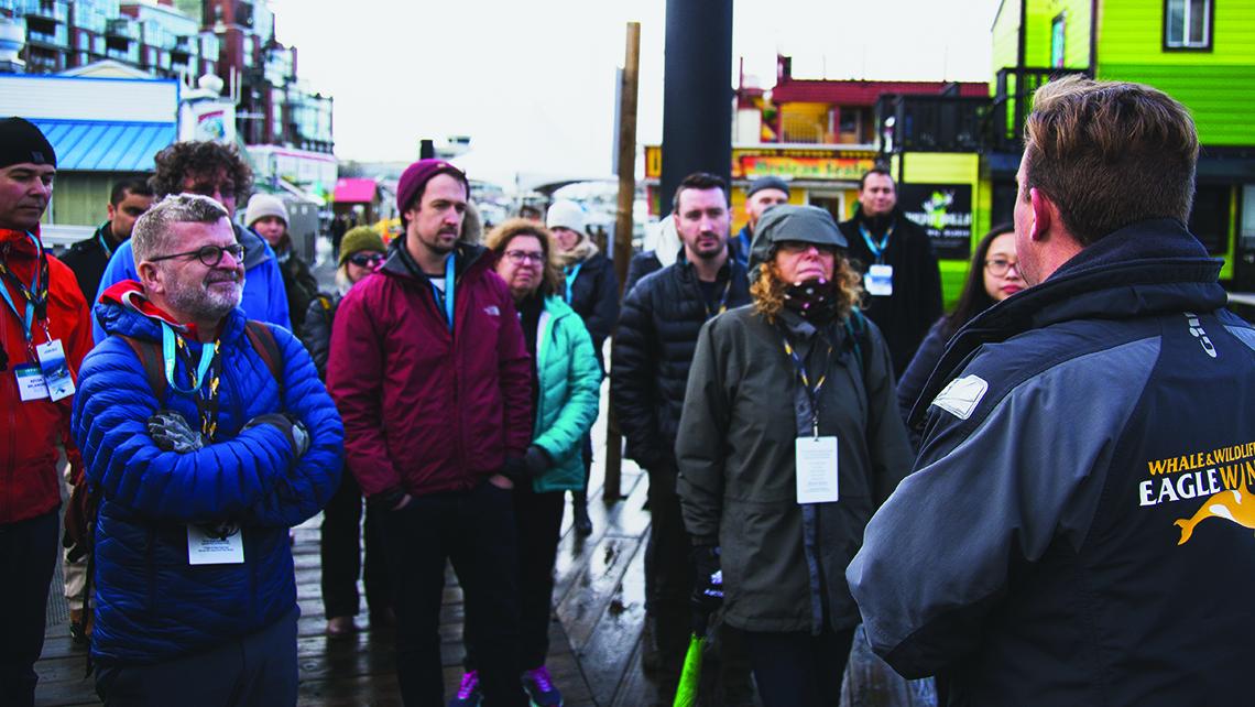 Delegates tour the revived Victoria Harbour in winter rain.