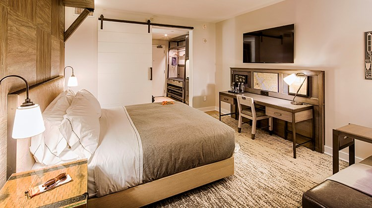 Guestrooms feature wooden ''canopies'' that envelope the bed and side-table areas. A luggage perch replaces the closet, while work desks are wide and relatively shallow.