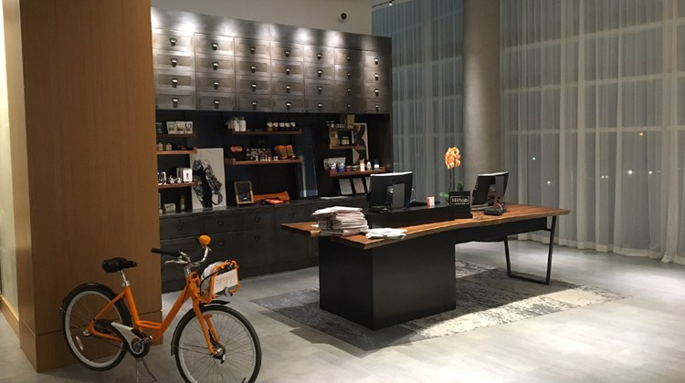 The front desk at the Canopy by Hilton Washington D.C. The Wharf, the brand's first in the U.S., offers a sense of playfulness as well as sales of items such as socks and locally-made chocolates and jerky treats.
