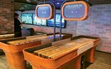 These shuffleboard games are part of the entertainment at Playmakers.