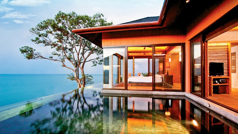 A pool villa at Sri Panwa. Amenities there include a private beach, tennis courts, muay thai boxing ring and six dining options.