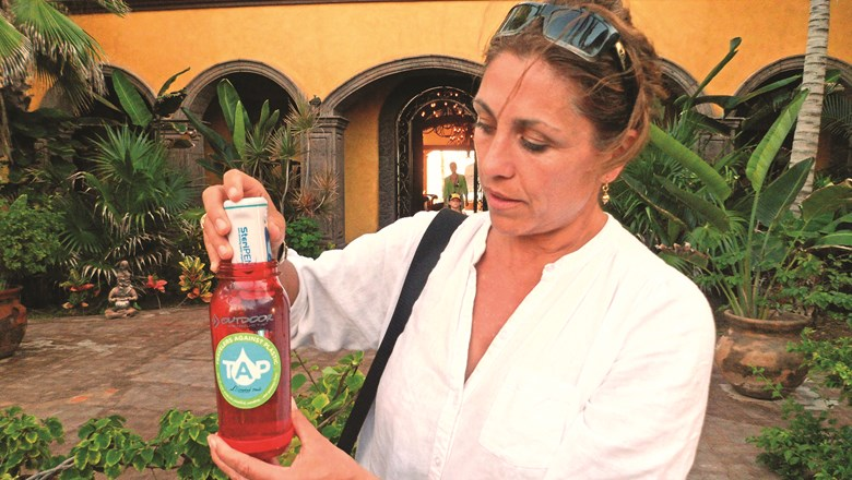 Christine Mackay, co-founder of Travelers Against Plastics, demonstrates how she uses a SteriPEN to purify water in Mexico.
