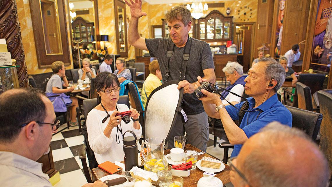Photojournalist and travel writer Mark Edward Harris, center,  teaches photo workshops on Uniworld cruises.