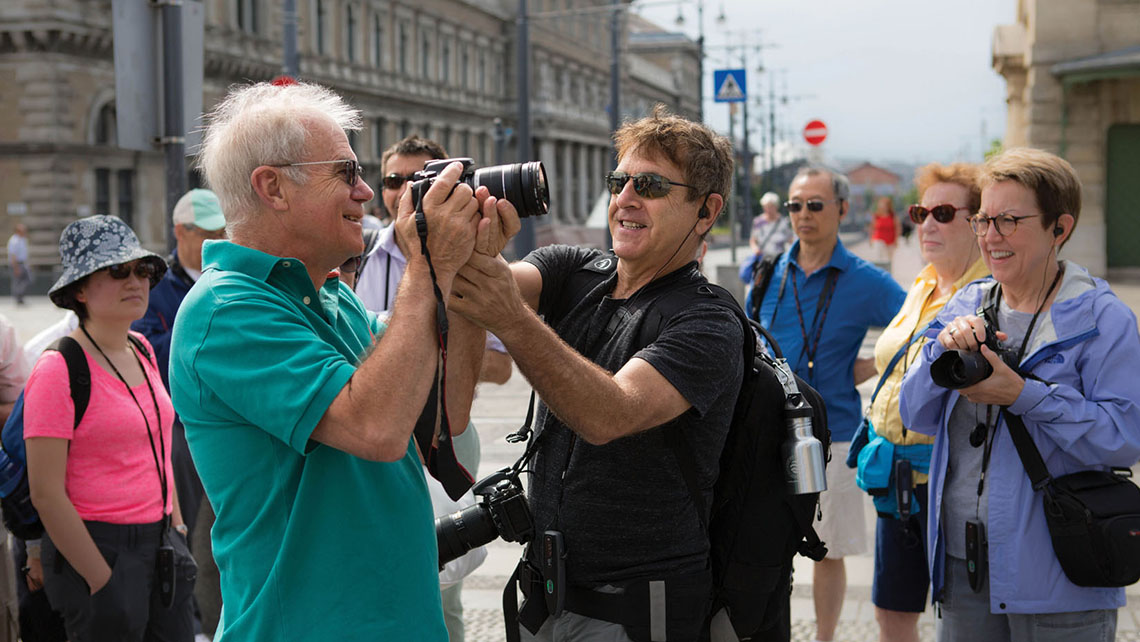 Mark Edward Harris assists a photography workshop participant during an excursion.