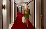 Carpeted in TWA's signature red, the curved hallway features walnut trim, walnut doors and terrazzo guest room entryways.