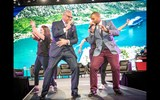 Attendees were treated to several sessions featuring top cruise executives, including Carnival Corp. CEO Arnold Donald, left, who concluded his keynote with some deft dance moves alongside Carnival entertainers.