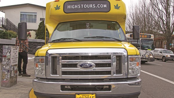 High 5 Tours' bright yellow Cannabus waits for guests of its CannaPDX tour outside the Doug Fir Lounge.