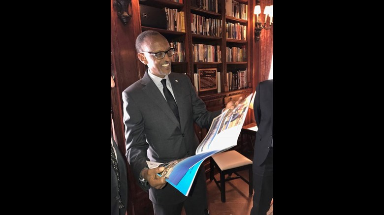 Rwandan president Paul Kagame reads the April 23, 2018 Travel Weekly cover story ''Rwanda Rising,'' about the making of Peter Greenberg's ''Rwanda -- The Royal Tour.'' He was in New York on April 24 for a screening of the film prior to its premiere on PBS.