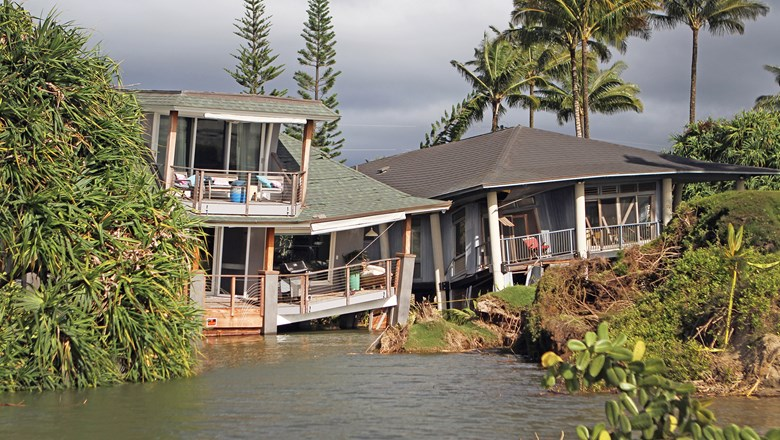 Damaged homes west of Hanalei Pier in Kauai after record rains and flooding in April.