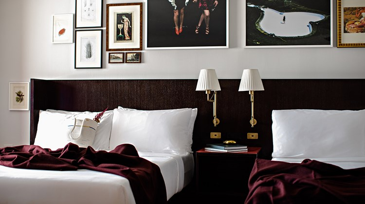The Nightingale Suite has two queen-size beds with luxury linens.