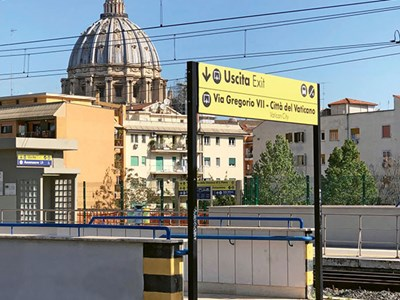 The San Pietro station with the dome of St. Peter's Basilica in the background.