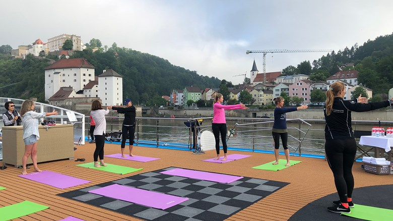 Wellness instructor Selina Wank leads a stretching and core-strengthening class on the sun deck of the AmaLea.