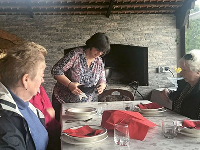 Uniworld passengers enjoy a home-cooked meal in Osijek, Croatia.