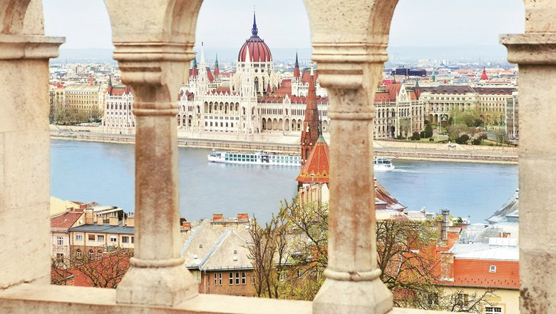 Uniworld's Beatrice cruises past the Hungarian Parliament Building in Budapest, a highlight of Lower Danube cruises.