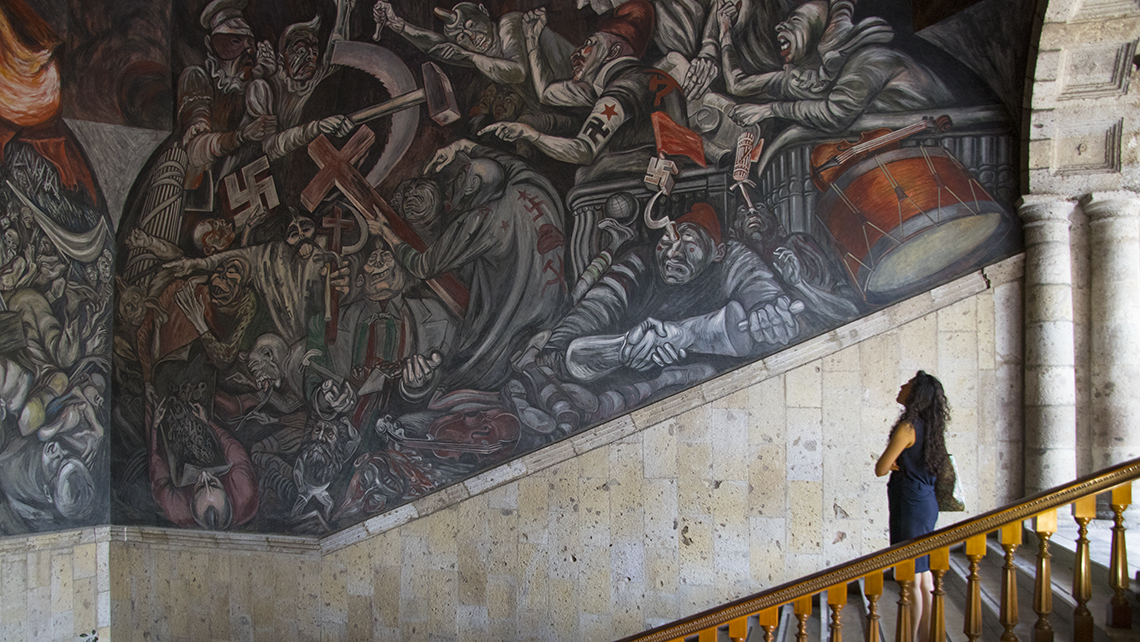 The stairwell of the Palacio de Gobierno features a fresco mural by Jose Clemente Orozco depicting key World War II figures as well as Miguel Hidalgo, a leader in the Mexican War of Independence.