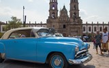 A 1951 Plymouth parked outside the Basilica of Our Lady of Zapopan.