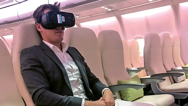 A passenger using Inflight VR's virtual reality headset, which is in the early stages of deployment.
