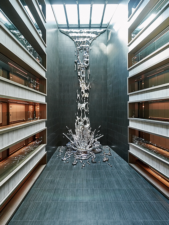 A sculpture at the VP Plaza Espana Design was created to look as if water was cascading from the outdoor pool to the lobby below.
