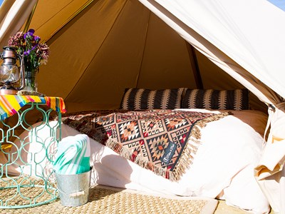"A Heritage Inspiration tent that is set up in the wilderness as part of its ""Journey Within"" glamping trips in the Taos wilderness."