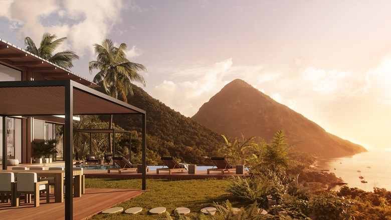 The pool deck at one of the new Piton Residences at Sugar Beach, A Viceroy Resort in St. Lucia, has views of the Pitons and the Caribbean Sea.