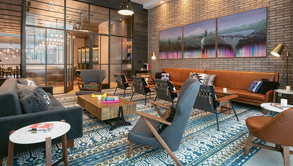 Decor at the Canopy by Hilton Portland Pearl District includes raw steel, Pendleton wool fabrics, industrial touches and artwork procured through Portland galleries.