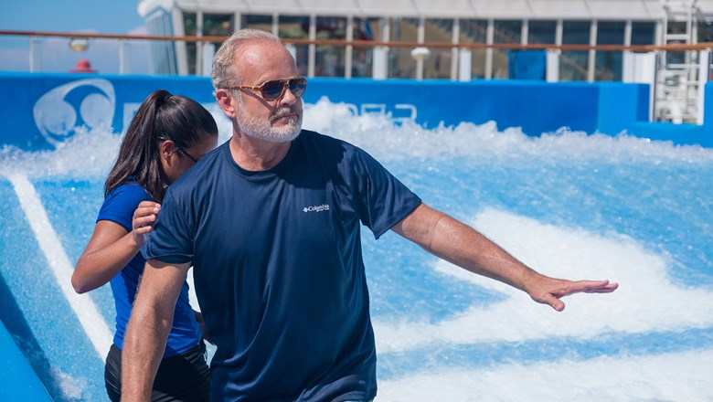 Actor Kelsey Grammer doing the Flow Rider on Harmony of the Seas.