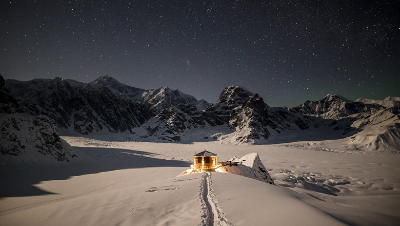 Sheldon Chalet is tucked on a rocky outpost above the Don Sheldon Amphitheater on Denali's Ruth Glacier.