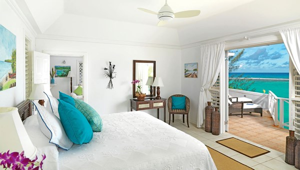 A bedroom in one of the Inn's seven cottages. The small luxury resort also features three private beachfront bungalows.
