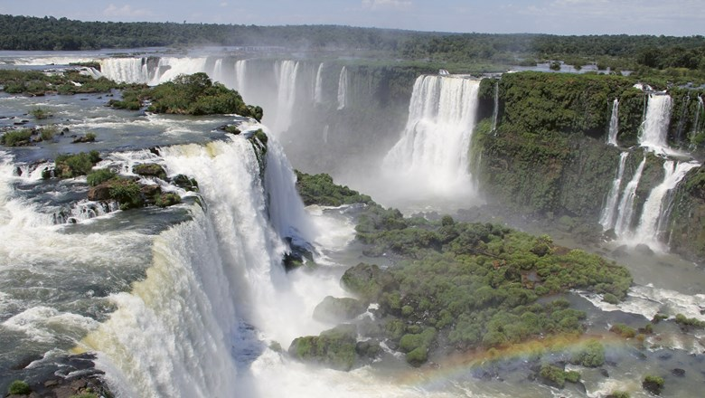 Iguazu Falls on the Brazil-Argentina border puts lesser falls to shame with its sheer size and natural beauty.
