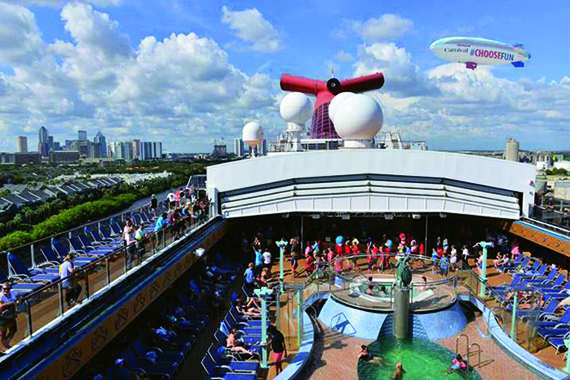 The blimp hovers over a Carnival ship during its seven-state tour.