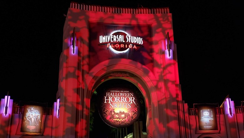 universal studios entrance is dimly lit each night of halloween horror nights