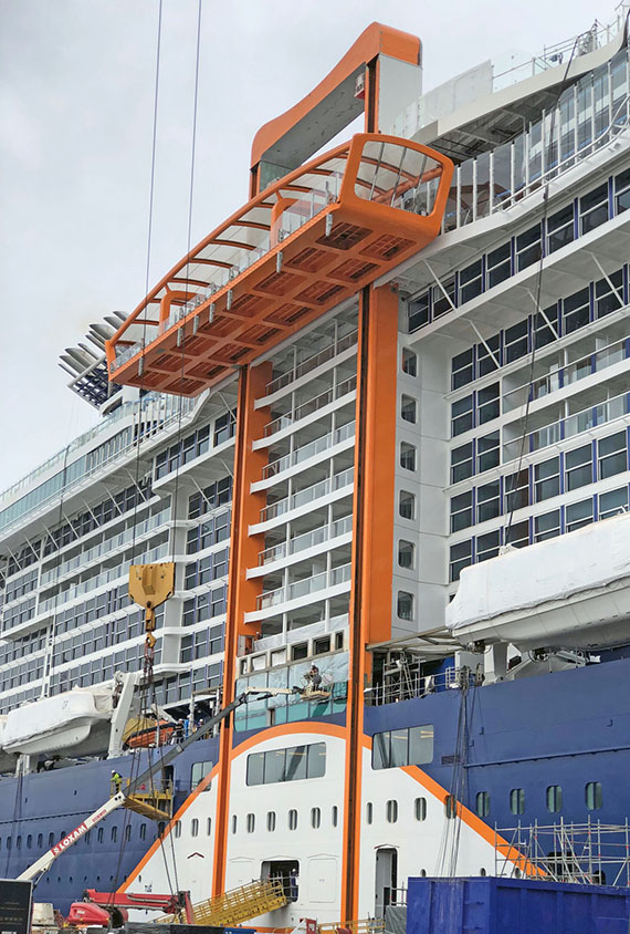The Magic Carpet moving platform clinging to the side of the Celebrity Edge stands out in both form and function.