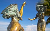 The Triton and Mermaid statue along the Malecon.