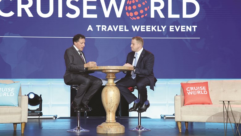 Royal Caribbean Cruises Ltd. CFO Jason Liberty, right, with editor in chief Arnie Weissmann at CruiseWorld.