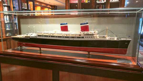 A scale model of the SS America is part of a memorabilia collection in the Pride of America's Library.