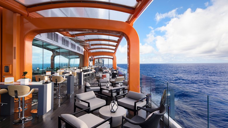 The highlight of Celebrity Edge's outward-facing vision, Magic Carpet is a cantilevered, moving platform that reaches a height of 13 stories above sea level.