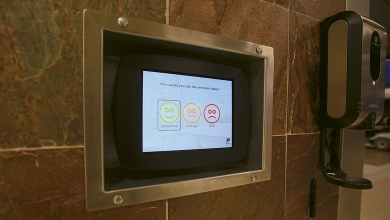 A tablet for travelers to report their airport bathroom experience.