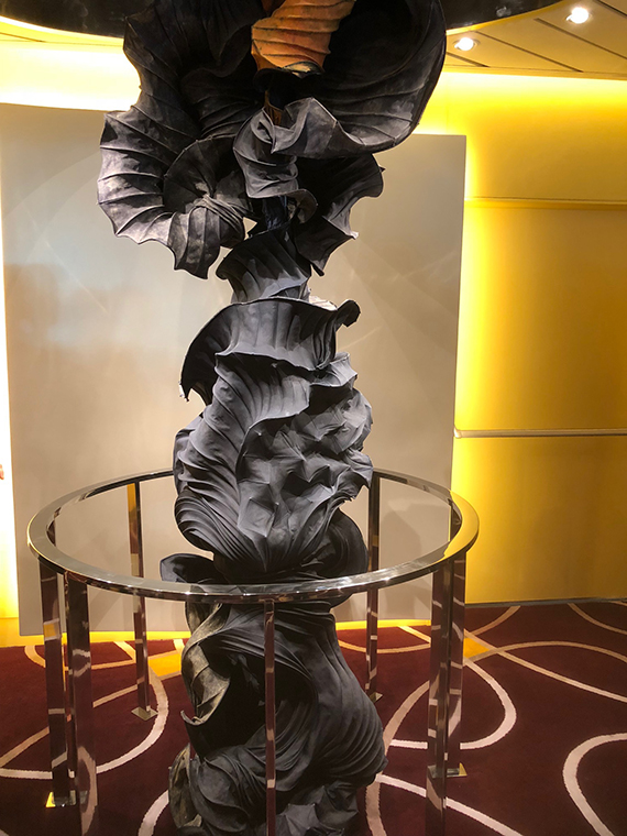 This sculpture, which spans two decks through an opening in the main dining room ceiling was inspired by sound waves.