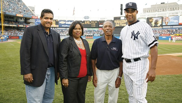 Early in her 12-year tenure, in 2007, Nicholson-Doty visited New York to launch a marketing partnership between the U.S. Virgin Islands Department of Tourism and the New York Yankees. With Nicholson-Doty, from left: John deJongh, then the governor of the USVI; Horace Clarke, a former Yankee and native Virgin Islander; and relief pitcher Jose Veras.