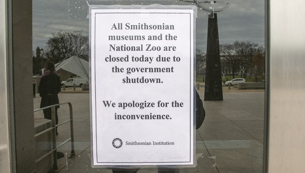 """Closed"" signs greet visitors at the National Museum of American History. All Smithsonian museums and the National Zoo are closed because of the government shutdown. Some tour operators, including Context Travel and G Adventures, have been forced to alter itineraries because of the closing of national parks and attractions."