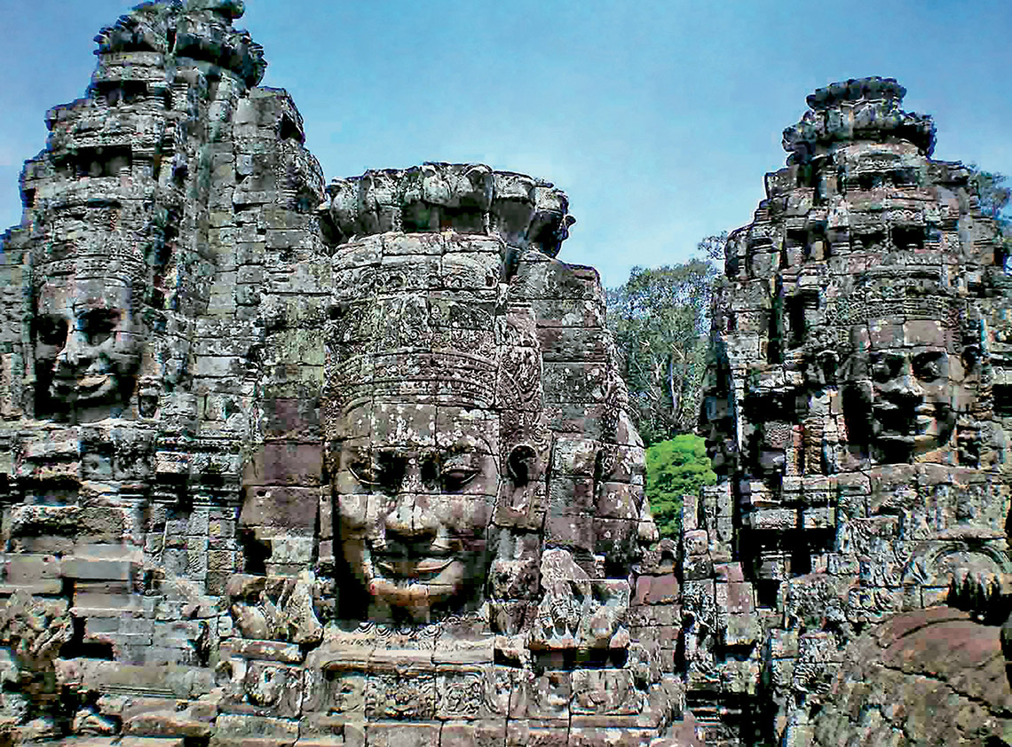 Ancient faces look on across time at Angkor Thom in Cambodia.