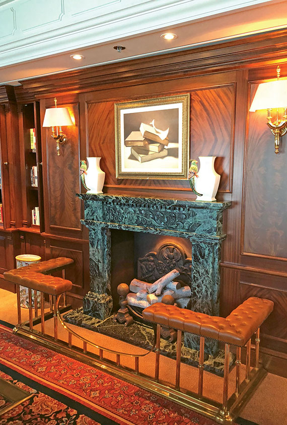 The faux fireplace in the Insignia library was left unchanged with the recent redesign.