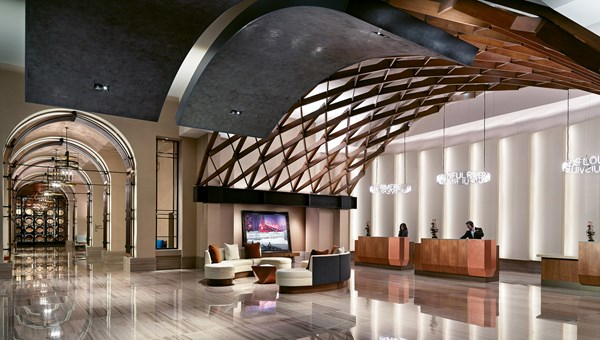 The Omni Louisville hotel, which opened last spring, takes many of its design cues from bourbon, including a whiskey barrel-inspired ceiling in the lobby.